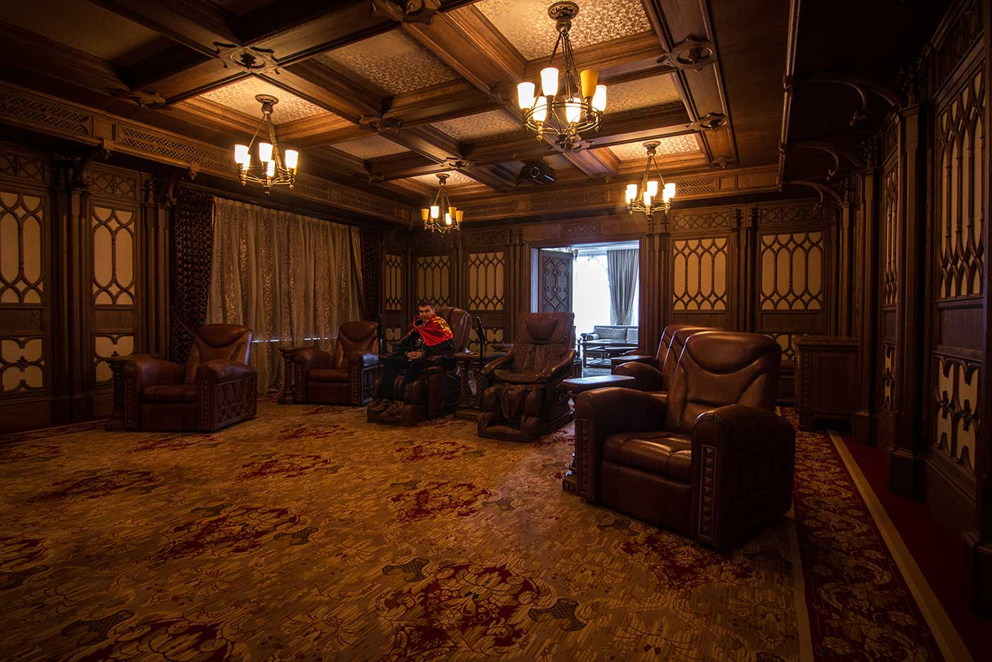 The home cinema at the Mezhyhirya residence featured Gothic-style wood panelling and eight leather armchairs. The two in the centre, reserved for Yanukovich and his mistress, were fitted with massagers.