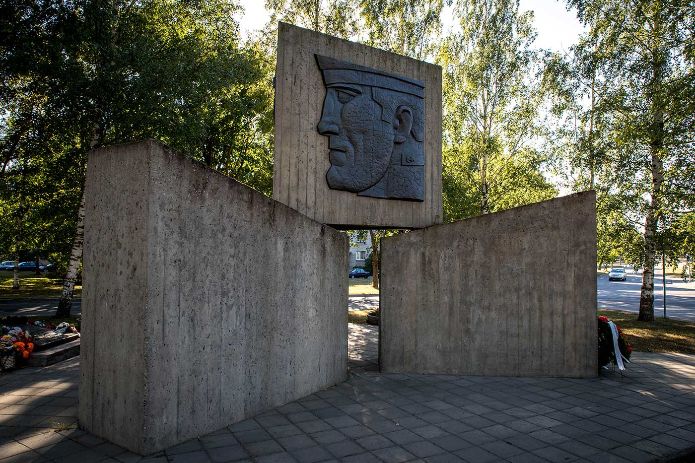 A monument to the Soviet army, depicting the faces of a soldier, pilot, and sailor.