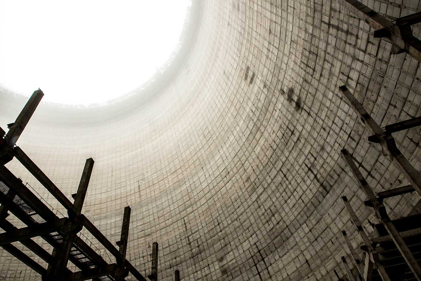 January mist gathers inside the cooling tower that was being built for Chernobyl Reactor Block 5. Construction was halted in 1986, after the disaster, leaving both the new reactor block and this cooling tower unfinished.