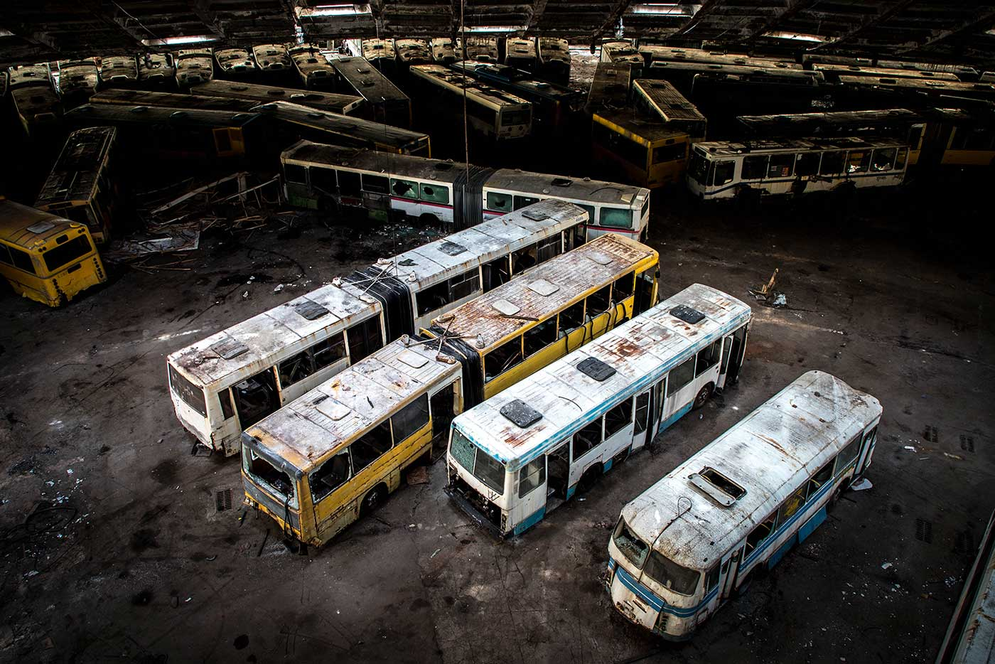 From above, the scale of Autobus Park №7 begins to sink in. From this distance the hundreds of abandoned buses look almost like toys. Autobus Park №7: the abandoned bus depot in Kyiv, Ukraine.