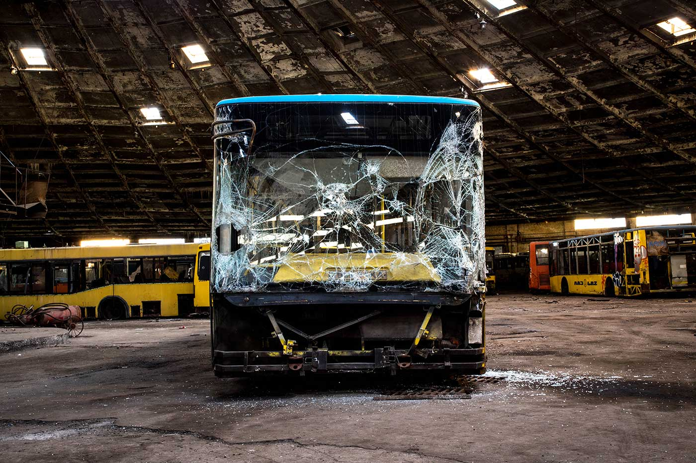 Many of the vehicles in Autobus Park №7 today were retired here after being damaged in road accidents. Autobus Park №7: the abandoned bus depot in Kyiv, Ukraine.