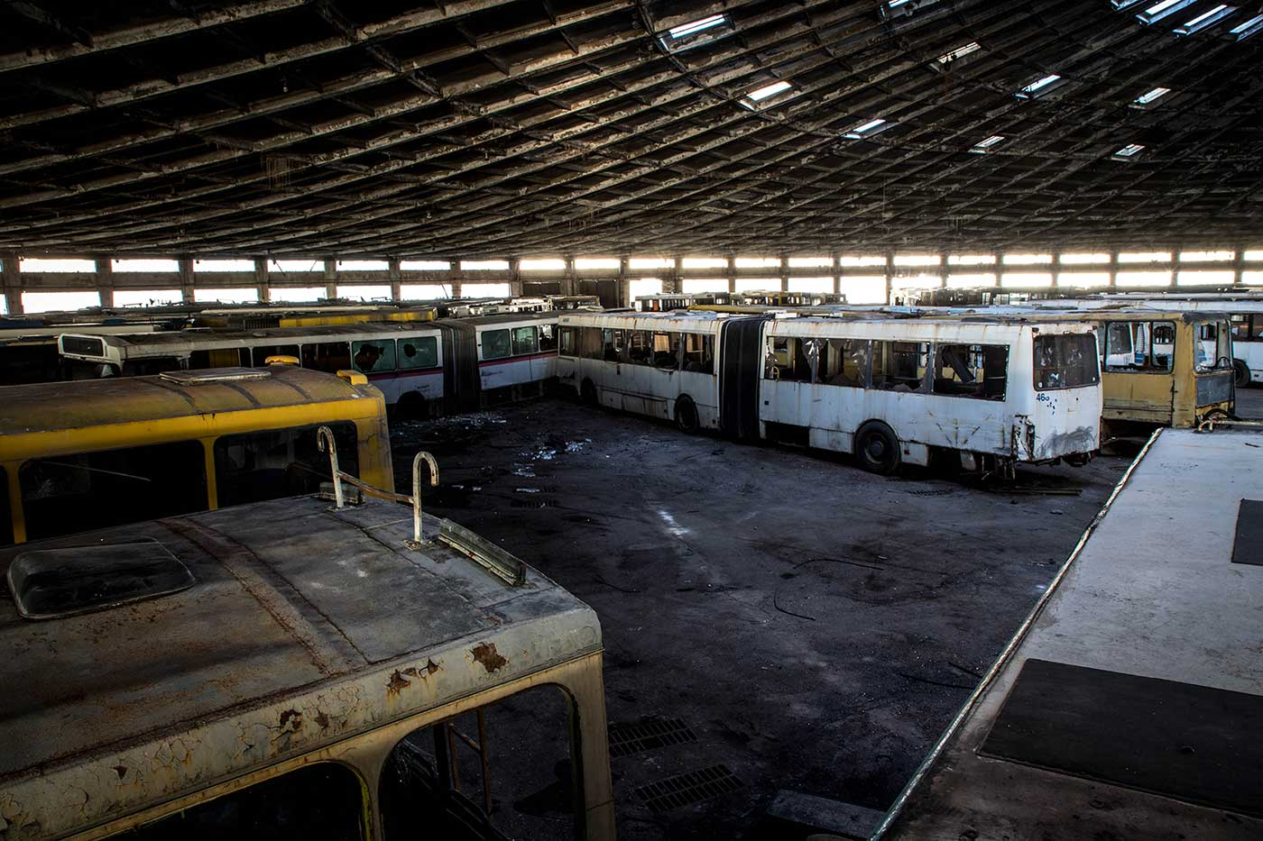 View from the top of a retired intercity bus. Autobus Park №7: the abandoned bus depot in Kyiv, Ukraine.