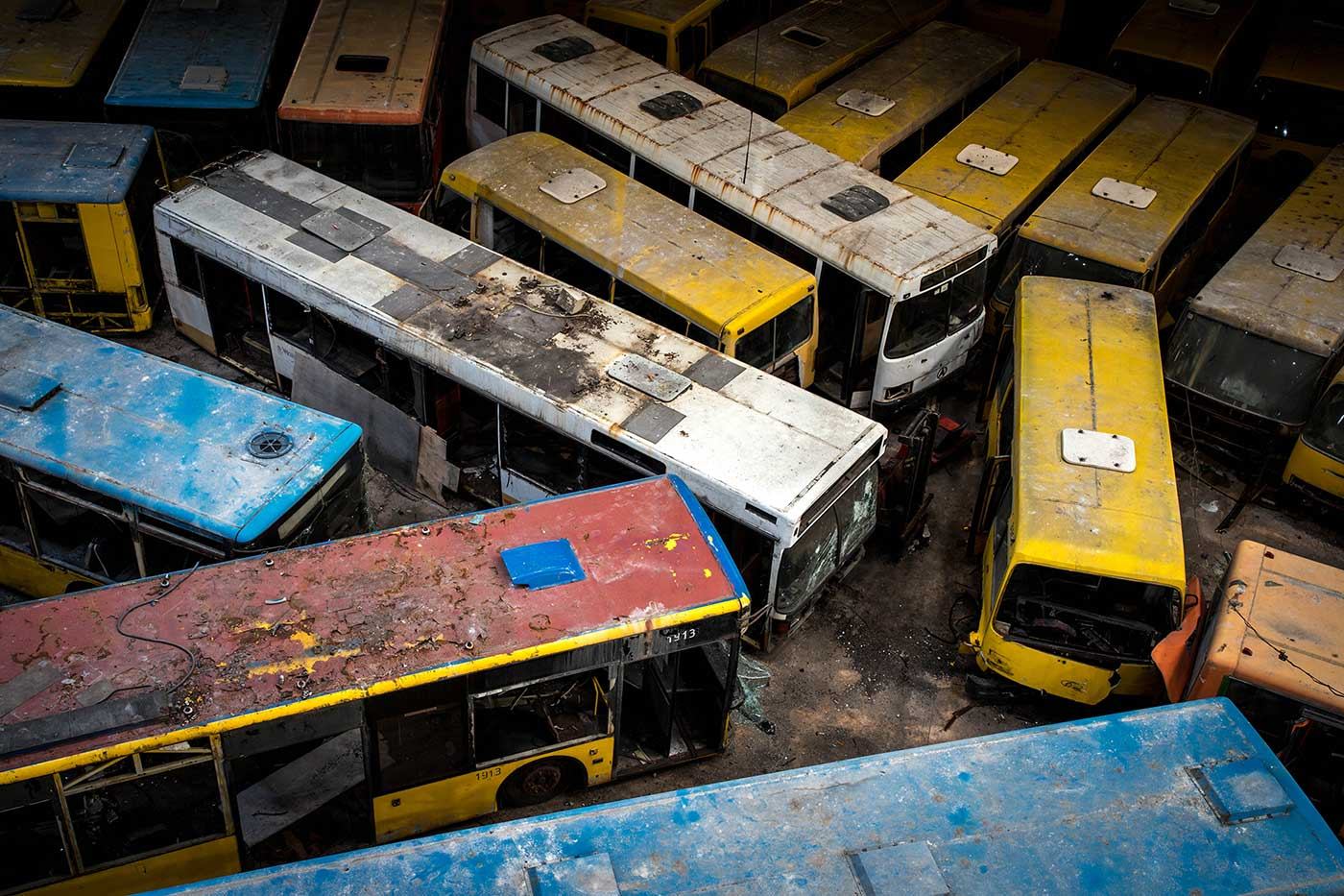Since it was officially closed in 2015, almost 1,000 buses have been stored inside the abandoned building. Autobus Park №7: the abandoned bus depot in Kyiv, Ukraine.