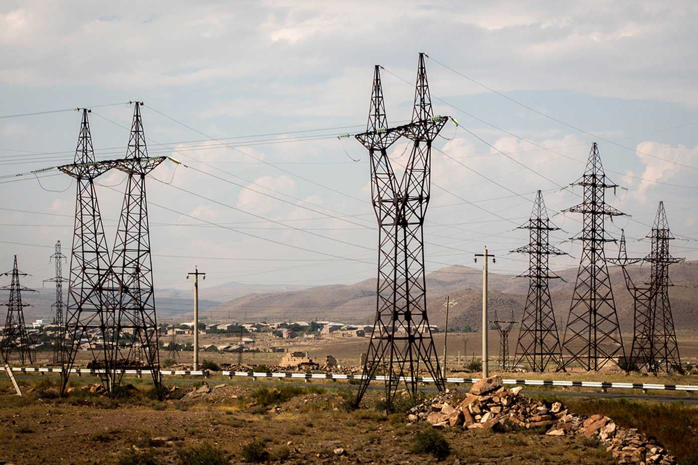 A humming troop of pylons in the lowlands.