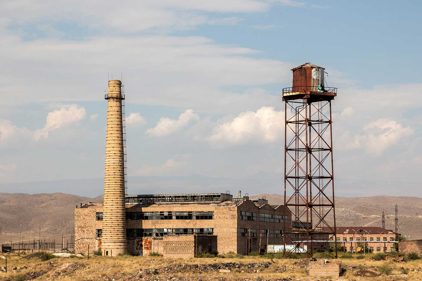 Remnants of past industry lay scattered about the plains.